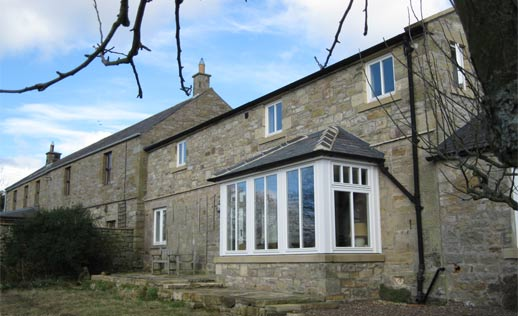 Substantial cottage extension next to listed building